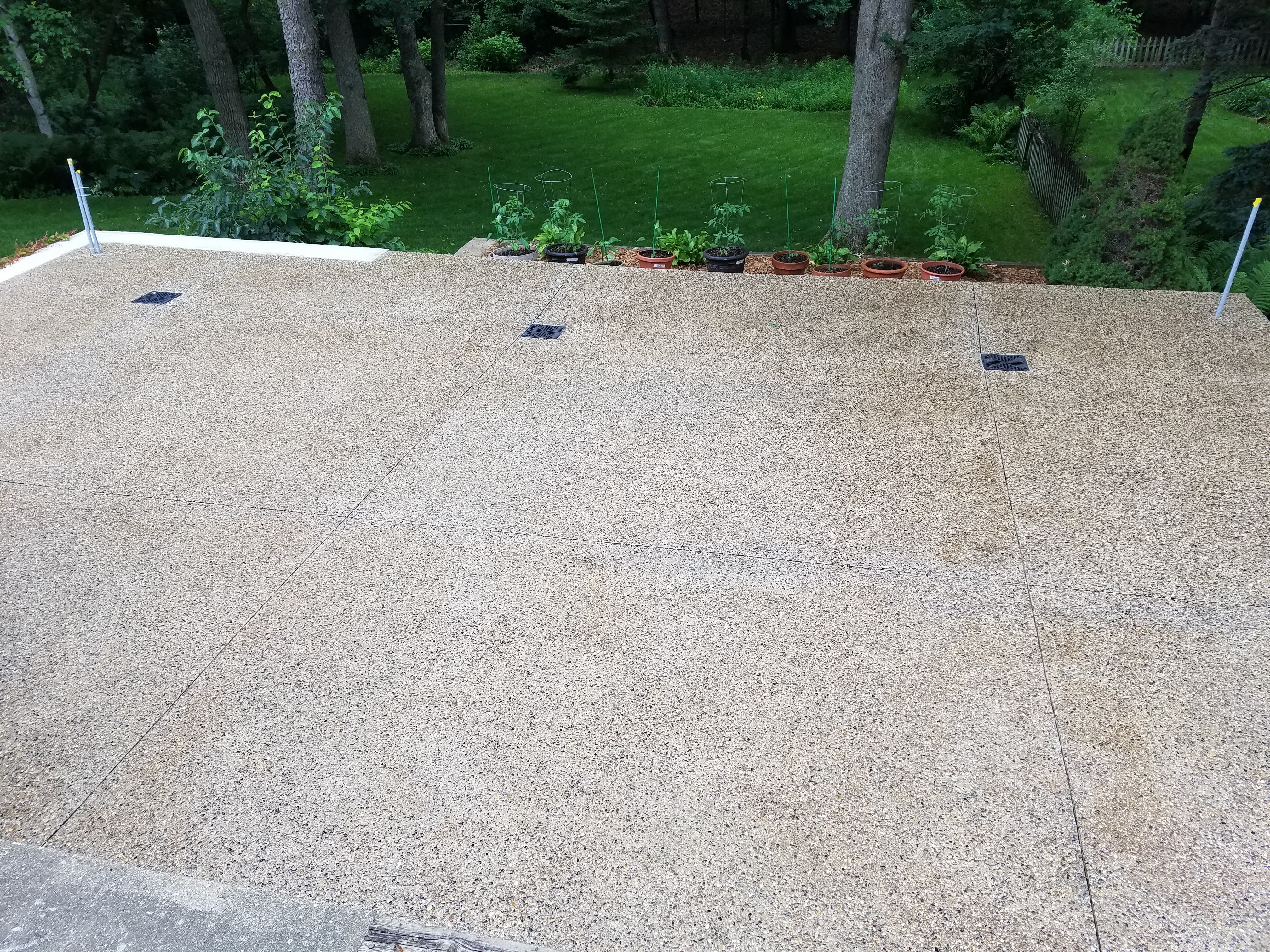 Exposed Aggregate Patio With Drains